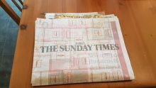 photo of Sunday Times wrapped in advertising cover for Chanel's marketing